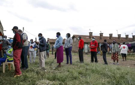 Kenyans queue to receive the AstraZeneca coronavirus vaccine donated by Britain, at the Makongeni Estate in Nairobi, Kenya Saturday, Aug. 14, 2021.