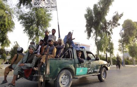 Taliban fighters patrol inside the city of Kandahar, southwest Afghanistan, Sunday, Aug. 15, 2021.