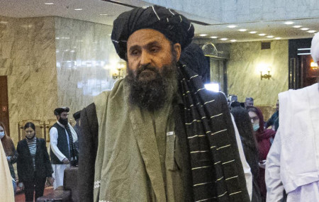 In this March 18, 2021, file photo, Taliban co-founder Mullah Abdul Ghani Baradar, arrives with other members of the Taliban delegation for an international peace conference in Moscow, Russia.