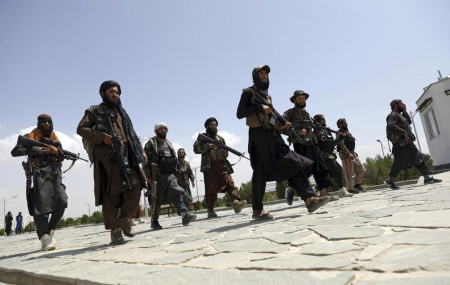 In this Aug. 19, 2021, file photo, Taliban fighters patrol in Kabul, Afghanistan.