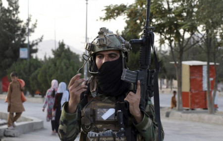 Taliban fighter stand guard at a checkpoint near the gate of Hamid Karzai international Airport in Kabul, Afghanistan, Saturday, Aug. 28, 2021.