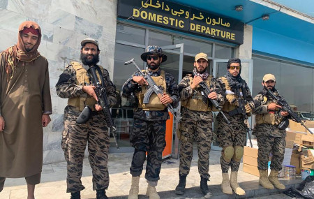 Taliban fighters stand guard inside the Hamid Karzai International Airport after the U.S. withdrawal in Kabul, Afghanistan, Tuesday, Aug. 31, 2021.
