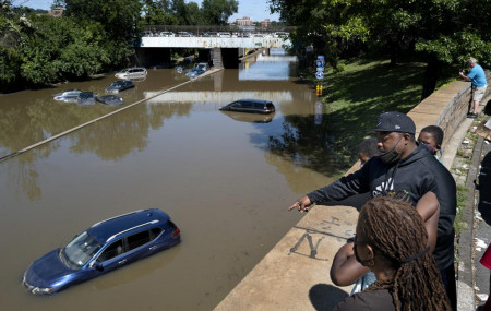Cars and trucks are stranded by high water Thursday, Sept 2, 2021, on the Major Deegan Expressway in Bronx borough of New York as high water left behind by Hurricane Ida still stands on the highway hours later.