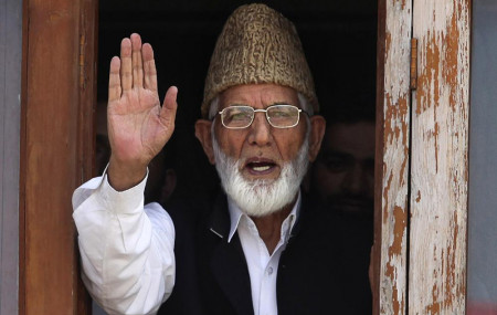 In this Wednesday, Sept. 8, 2010, file photo, Kashmiri separatist leader Syed Ali Shah Geelani waves to the media before his arrest in Srinagar, India.