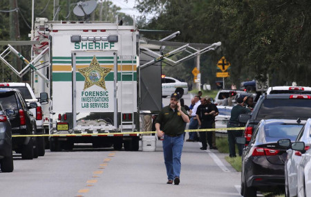 Polk County, Florida, Sheriff's officials work the scene of a multiple fatality shooting Sunday, Sept. 5, 2021, in Lakeland, Floridaa.