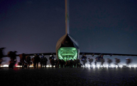 In this Aug. 30, 2021, file photo provided by the U.S. Air Force, soldiers, assigned to the 82nd Airborne Division, prepare to board a U.S. Air Force C-17 Globemaster III aircraft at Hamid Karzai International Airport in Kabul, Afghanistan.