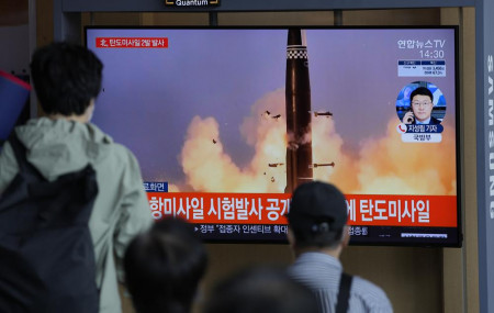 People watch a TV screen showing a news program reporting about North Korea's missiles with file image in Seoul, South Korea, Wednesday, Sept. 15, 2021.
