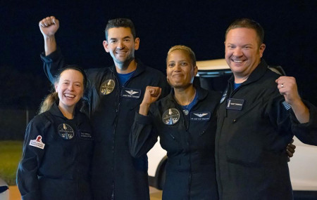 In this image released by Inspiration4, passengers aboard a SpaceX capsule, from left to right, Hayley Arceneaux, Jared Isaacman, Sian Proctor and Chris Sembroski pose after the capsule was recovered following its splashdown in the Atlantic.
