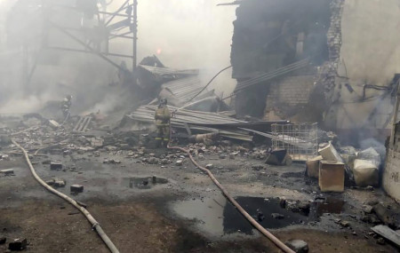 Emergency personnel work at the site of an explosion and fire at a gunpowder factory in the Ryazan region, about 270 kilometers (about 167 miles) southeast of Moscow, Russia, Friday, Oct. 22, 2021.
