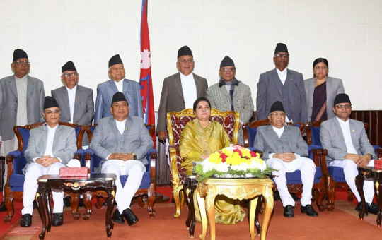 The newly appointed provincial chiefs (standing) pose for photographs with President Bidya Devi Bhandari (sitting at center), PM KP Sharma Oli (on her right) and others.