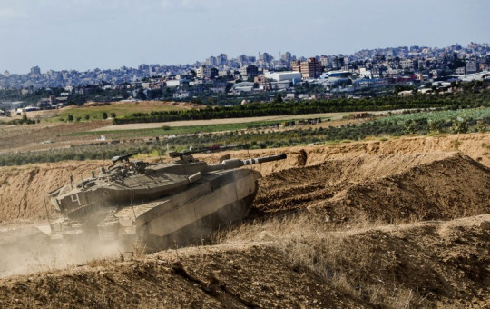 "In this Oct. 27, 2018, file photo, Israeli tank takes a position at the Gaza Strip border. The Israeli military on Wednesday said it has carried out a ""wide-scale"" strike on Iranian targets in Syria following a rocket attack on the  Golan Heights."