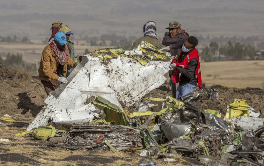 In this file photo dated Monday, March 11, 2019, rescuers work at the scene of an Ethiopian Airlines plane crash south of Addis Ababa, Ethiopia.