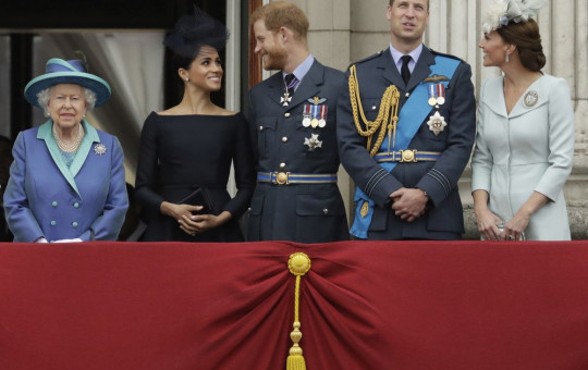 File photo of Britain's Queen Elizabeth II, and from left, Meghan the Duchess of Sussex, Prince Harry, Prince William and Kate the Duchess of Cambridge