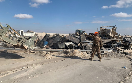 U.S. soldiers clear rubble from a site of Iranian bombing at Ain al-Asad air base in Anbar, Iraq, Monday, Jan. 13, 2020.