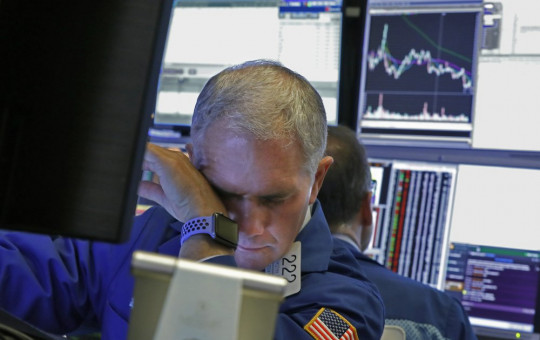 Specialist Timothy Nick works on the floor of the New York Stock Exchange, Monday, March 9, 2020.