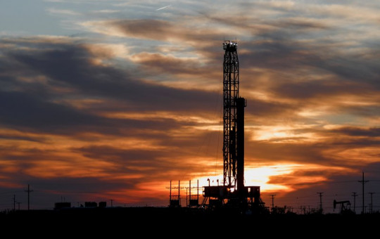An oil rig stands against the setting sun in Midland, Texas on Friday, April 17, 2020.