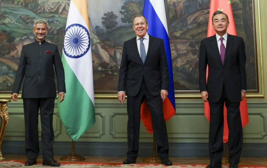 In this photo released by the Russian Foreign Ministry Press Service, India's Foreign Minister S. Jaishankar, left, Russia's Foreign Minister Sergey Lavrov, and China's Foreign Minister Wang Yi, pose for a photo.