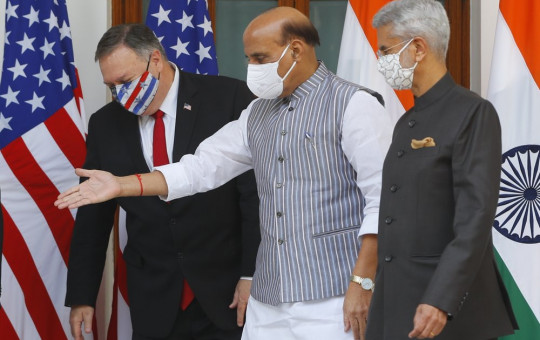 Indian Defence Minister Rajnath Singh, center, gestures towards U.S. Secretary of State Mike Pompeo, left, with Indian Foreign Minister Subrahmanyam Jaishankar, right, standing beside him, ahead of their meeting at Hyderabad House in New Delhi, India.