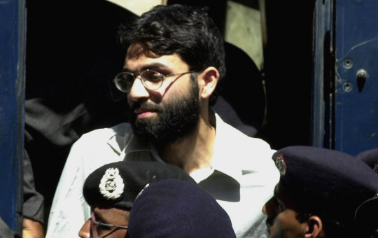 In this March 29, 2002 file photo, Ahmed Omar Saeed Sheikh, the alleged mastermind behind Wall Street Journal reporter Daniel Pearl's kidnap-slaying, appears at the court in Karachi, Pakistan.