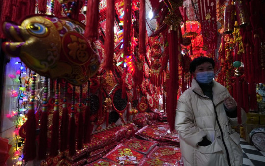 Gong Linhua, a seller of Lunar New Year decorations, speaks about the impact of the coronavirus on her business ahead of the Year of the Ox Chinese Lunar New Year celebrations in Wuhan in central China's Hubei province on Tuesday.