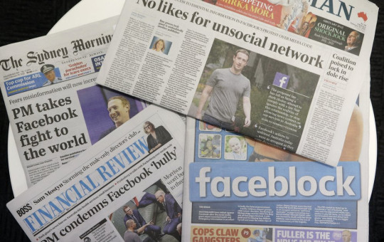Front pages of Australian newspapers are displayed featuring stories about Facebook in Sydney, Friday, Feb. 19, 2021.