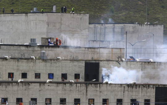 Tear gas rises from parts of Turi jail where an inmate riot broke out in Cuenca, Ecuador, Tuesday, Feb. 23, 2021.
