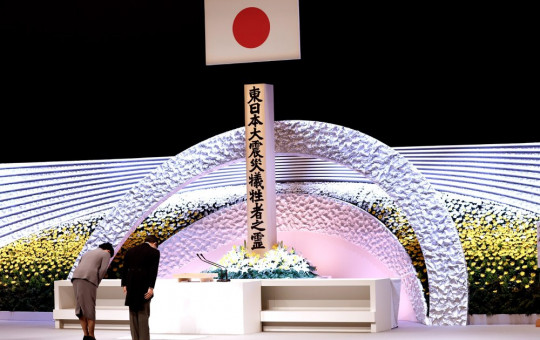 Japan's Emperor Naruhito, right, and Empress Masako bow in front of the altar for victims of the March 11, 2011 earthquake and tsunami at the national memorial service in Tokyo, Thursday, March 11, 2021.
