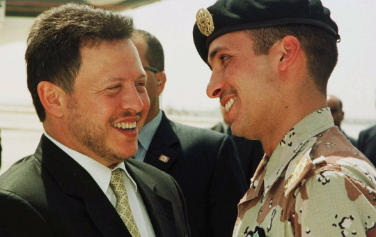 In this April 2, 2001, file photo, Jordan's King Abdullah II laughs with his half brother Prince Hamzah, right, shortly before the monarch embarked on a tour of the United States.