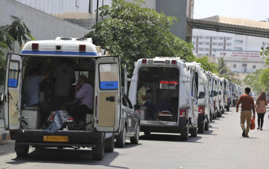 Ambulances carrying COVID-19 patients line up waiting for their turn to be attended at a dedicated COVID-19 government hospital in Ahmedabad, India, Thursday, April 22, 2021.