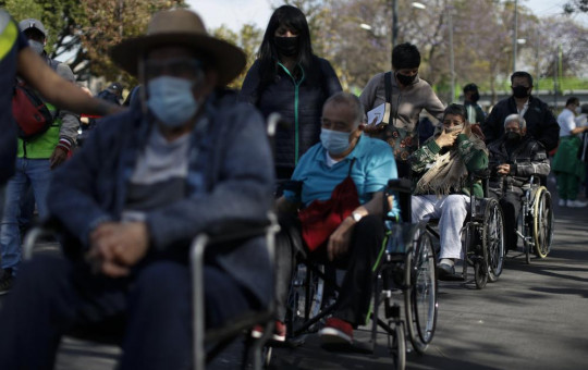 In this Feb. 24, 2021, file photo, elderly residents of the Iztacalco borough wait in line to receive doses of the Russian COVID-19 vaccine Sputnik V in Mexico City.