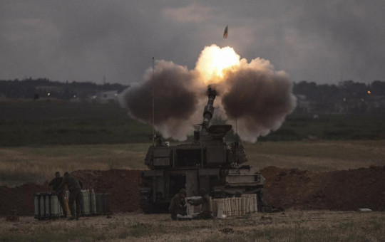 An Israeli artillery unit fires toward targets in the Gaza Strip, at the Israeli Gaza border, Monday, May 17, 2021.