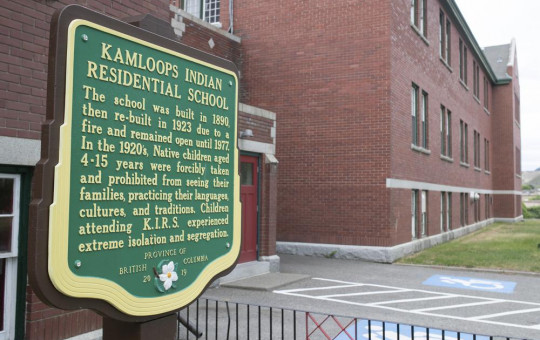 A plaque is seen outside of the former Kamloops Indian Residential School on Tk'emlups te Secwépemc First Nation in Kamloops, British Columbia, Canada on Thursday, May 27, 2021.