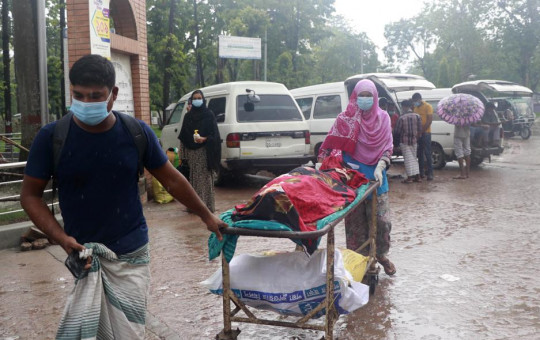 People leave for home with body of a relative at the Medical College Hospital in Rajshahi, 254 kilometers (158 miles) north of the capital, Dhaka, Bangladesh, June 15, 2021.