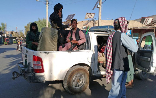 Taliban fighters patrol inside the city of Farah, capital of Farah province southwest of Kabul, Afghanistan, Wednesday, Aug. 11, 2021.
