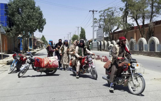 Taliban fighters patrol inside the city of Ghazni, southwest of Kabul, Afghanistan, Thursday, Aug. 12, 2021.