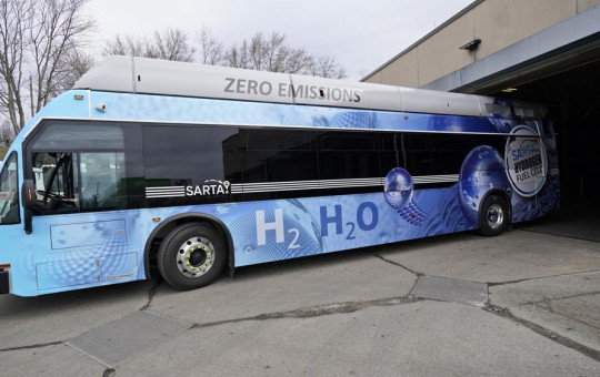 Kevin Baker, a maintenance technician, drives a hydrogen fuel cell bus out of the terminal, Tuesday, March 16, 2021, in Canton, Ohio.