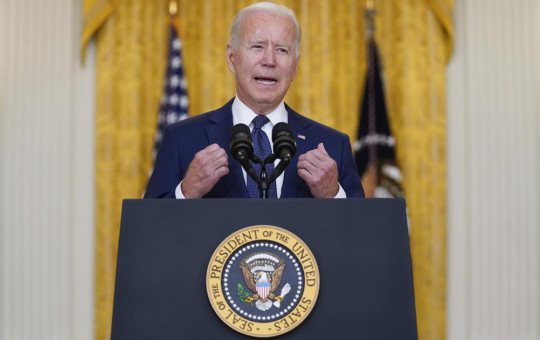 US President Joe Biden speaks about the bombings at the Kabul airport that killed at least 12 U.S. service members, from the East Room of the White House, Thursday, Aug. 26, 2021, in Washington.