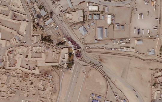 In this satellite photo taken by Planet Labs Inc., a massive crowd is seen at the gate marking the border crossing between Spin Boldak, Afghanistan, and Chaman, Pakistan, Thursday, Aug. 26, 2021.