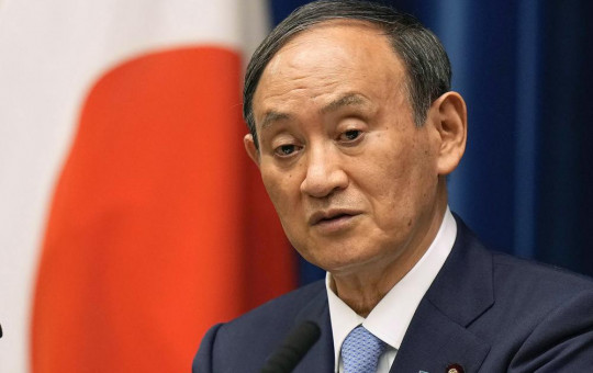 In this Aug. 17, 2021, file photo, Japanese Prime Minister Yoshihide Suga speaks during a news conference at prime minister's official residence in Tokyo.
