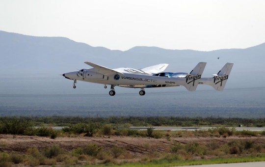 In this Sunday, July 11, 2021 file photo, the craft carrying Virgin Galactic founder Richard Branson and other crew members takes off from Spaceport America near Truth or Consequences, New Mexico.