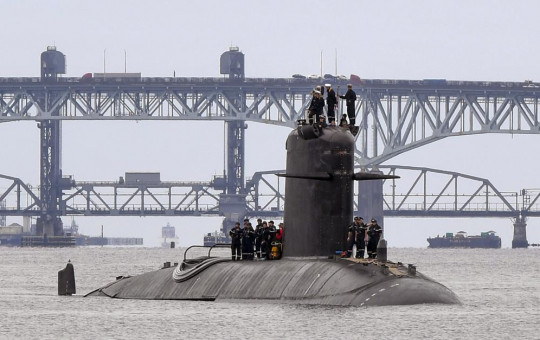 In this photo provided by U.S. Navy, French submarine FNS Amethyste (S605) transits the Thames River in preparation to arrive at Naval Submarine Base New London in Groton, Connecticut, Sept. 1.2021.