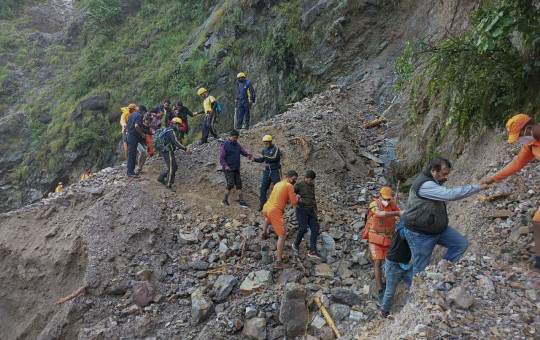 This photograph provided by India's National Disaster Response Force (NDRF) shows NDRF personnel rescuing civilians stranded following heavy rains at Chhara village near Nainital, Uttarakhand, Wednesday, Oct. 20, 2021.