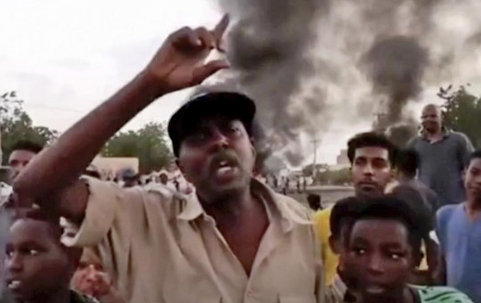 In this frame taken from video people gather during a protest in Khartoum, Sudan, Monday, Oct. 25, 2021.